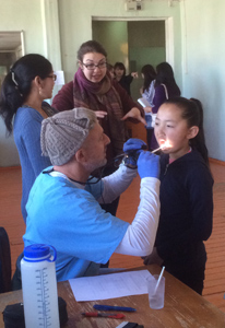 Dr. Jon doing examinations in Mongolia with Pediatric Dentist from Fort Lee and Westwood, NJ