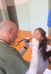 checking teeth in Mongolia with Pediatric Dentist from Fort Lee and Westwood, NJ